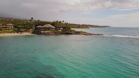Picturesque tropical panorama with beautiful bungalow on the shore of ocean on island maui,hawaii. Attractive scenary of the waters of pacific ocean and romantic stock video footage