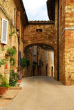 Picturesque Tuscany Alley. A picturesque corner in the narrow streets of Pienza Royalty Free Stock Images