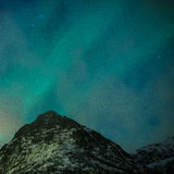 Picturesque Unique Northern Lights Aurora Borealis Over Lofoten Islands in Nothern Part of Norway Royalty Free Stock Image