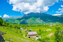 In a valley among the mountains there is a small village. Stock Images
