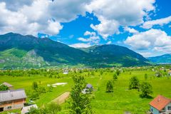 In a valley among the mountains there is a small village. Royalty Free Stock Photo