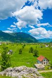 In a valley among the mountains there is a small village. Stock Image