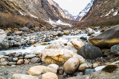 Picturesque valley with river and mountains with melting snow during spring Royalty Free Stock Images