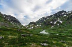 Picturesque valley between snowy rocks Stock Images