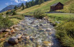 Picturesque valley with stream in Livigno, Italy stock photography