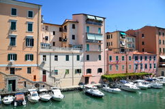 Picturesque view on boats in city channel in Livorno, Italy Stock Photos