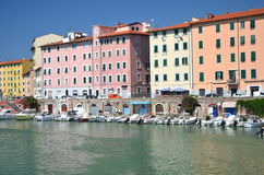 Picturesque view on boats in city channel in Livorno, Italy Royalty Free Stock Photo
