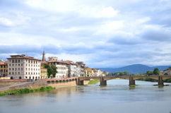 Picturesque view on Bridge alle Grazie over Arno River in Florence, Italy Royalty Free Stock Photos