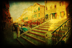 Picturesque view of a canal in Venice with a vintage style texture Royalty Free Stock Photography