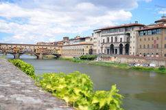 Picturesque view on colorful Ponte Vecchio over Arno River in Florence, Italy Stock Photo
