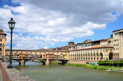 Picturesque view on colorful Ponte Vecchio over Arno River in Florence, Italy Stock Image