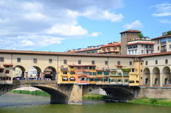 Picturesque view on colorful Ponte Vecchio over Arno River in Florence, Italy Royalty Free Stock Images