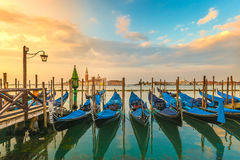Picturesque view famous gondolas sunrise Venice Italy. Picturesque sunrise view gondolas near San Marco early morning Venice Italy Royalty Free Stock Photo