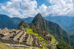 Picturesque view of famous Machu Picchu in Peru. Picturesque view of famous ruins of ancient Inca city of Machu Picchu in Peru, with vivid green grass and steep stock photos