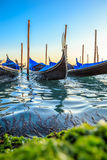 Picturesque view of Gondolas on lateral narrow Canal, Venice, Italy. Royalty Free Stock Image