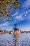 Picturesque View of Harlem Cityscape With De Adriaan Windmill on Spaarne River Stock Image