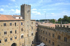 Picturesque view on historic buildings of Volterra in Tuscany, Italy Stock Photos