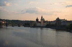 Picturesque view of the historical part of the city Prague during sunrise. Medieval Charles Bridge over Vltava River. Famous touristic place and travel royalty free stock photos
