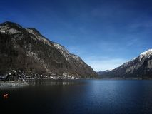 Picturesque view at the mountains, lake and Hallstatt village. royalty free stock photo