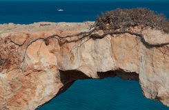 Picturesque view of a natural rock bridge at sea. Picturesque view of natural rock bridge at Cape Greco near Ayia Napa, Cyprus, Mediterranean Sea coast Stock Photo