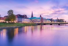 Picturesque view of an old European city in the evening. Skyline reflected in the water. Long exposure photography. Beautiful sunset in Malmo, Sweden stock images