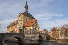 Picturesque view of the old Town Hall Altes Rathaus with two bridges over the Regnitz River of Bamberg. Germany Bavaria. Picturesque view of the old Town Hall stock photos
