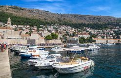 Picturesque view on the old town and port medieval Ragusa and Dalmatian Coast of Adriatic Sea, Dubrovnik, Croatia. royalty free stock photos