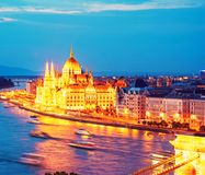 The picturesque view of of the Parliament and the bridge over the Danube in Budapest, Hungary, Europe in evening on lamps light.  stock images