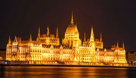 The picturesque view of of the Parliament in Budapest, Hungary, Europe in evening on lamps light.  stock photo