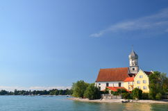 Picturesque view on Picturesque view on church in Wasserburg on Lake Bodensee, Germany Stock Image
