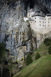 Picturesque view of the Predjama Castle situated in the middle of a towering cliff in Slovenia Royalty Free Stock Images