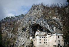 Picturesque view of the Predjama Castle situated in the middle of a towering cliff in Slovenia Stock Photo