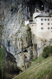 Picturesque view of the Predjama Castle situated in the middle of a towering cliff in Slovenia Stock Images