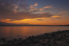 Picturesque view of river at sunset stock image