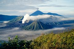 Spectacular smoking volcanos, Bromo and Semeru royalty free stock photography