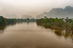 Landscape view at Song Day river and mountains. Picturesque view at the Song Day river when on the road to Ninh Binh from Hanoi Stock Photography
