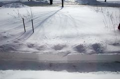 Snow Covered Yard with Shoveled Path after a Snowstorm stock images