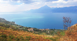 Picturesque view to garda lake and shrubbery in autumnal colors, Royalty Free Stock Photos