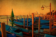 Picturesque view of Venice with vintage texture. Picturesque view of Venice with many gondolas behind each other, processed with a brown vintage style texture Royalty Free Stock Images