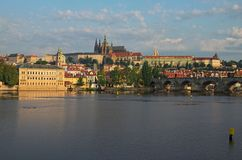 Picturesque view on Vltava river and Charles bridge. Prague Castle with ancient Saint Vitus Cathedral at the background. Summer morning landscape photo. Prague stock image