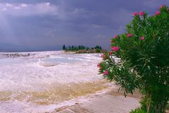 Picturesque view from the white salt mountain in Turkey to the sea in summer royalty free stock photography