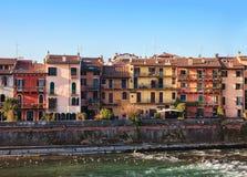 The picturesque views of the houses facades near the Adige river bank, Verona, Italy Stock Photos
