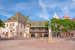 Picturesque village Alsatian of Colmar, France. Fountain of Baron Lazare de Schwendi in Place de l´Ancienne Douane, Colmar, Alsace, France Stock Image