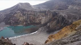 Picturesque volcanic landscape of Kamchatka: beautiful view of crater active Gorely Volcano, crater lake and fumarolic