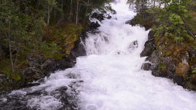 Picturesque waterfall Langfoss in Norway stock footage