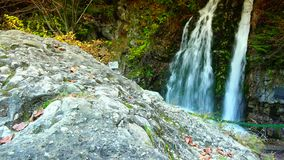 Picturesque waterfall in the mountains, pure fresh water waterfall in autumn forest;ULTRA HD 4K, real time, zoom stock footage