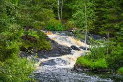 Picturesque waterfall near village Ruskeala, Karelia royalty free stock image
