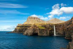 Picturesque waterfall in the village Gasadalur in the Faroe Islands