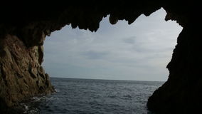 Picturesque waterfront cave stock footage