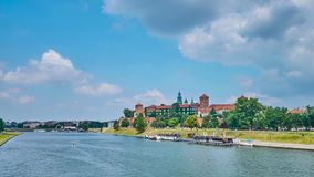The Wawel Castle by the Vistula river, Krakow, Poland. The picturesque Wawel Castle is hidden among lush greenery of park, covering the bank of Vistula river stock footage